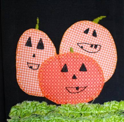 close-up-tea-towel-hand-applique-pumpkin